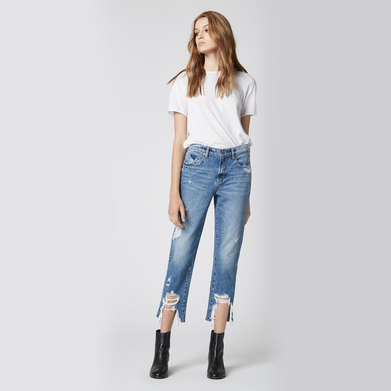 Blank NYC Madison Crop Happy Hour Jeans. These jeans are perfect for giving your look a little edge! Featuring a high rise fit, medium wash denim, distressed details, and a raw hem style. Pair with a white tee and chunky booties for the perfect look.