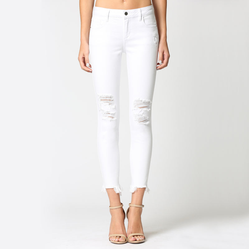Hidden Amelia Distressed Raw Hem Skinny Jean. Everyone needs a pair of white denim in their spring/summer wardrobe! This gorgeous pair features a distressed style, raw hem trim, and skinny fit. Pair with a blouse and heels for the most effortless, cute look!