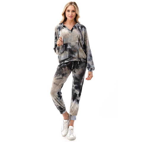 Long Sleeve Tie Dye Hoodie. Nail the tie-dye trend this season with this super fun piece! Featuring a neutral tie-dye printed material, long sleeves, v-neck style, adjustable jaw-string, and hooded detail. Pair with the matching high waisted joggers, crossbody bag, and fresh white kicks for a look we are obsessing over.