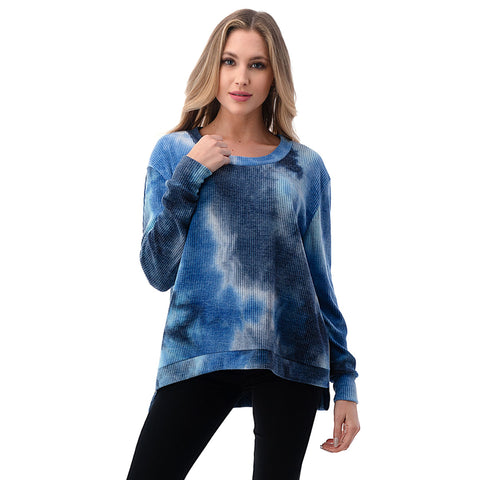 Long Sleeve Tie Dye Top. Keeping it comfy is essential this season, and this piece is at the top of our list! Featuring a tie dye material, long sleeves, thermal material, round neckline, and loose fit. Pair with your favorite leggings, slides, and a high pony for a look we are loving.