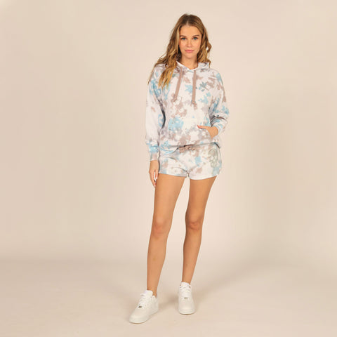 Vintage Havana Tie Dye Burnout Rhinestone Hoodie. Look fabulous while staying comfy with these gorg hoodie! Featuring a multi-colored tie dye material, adjustable jaw-string, and skull rhinestone detail. Pair with the matching shorts, white sneakers, and mini backpack for a cute running errands look.