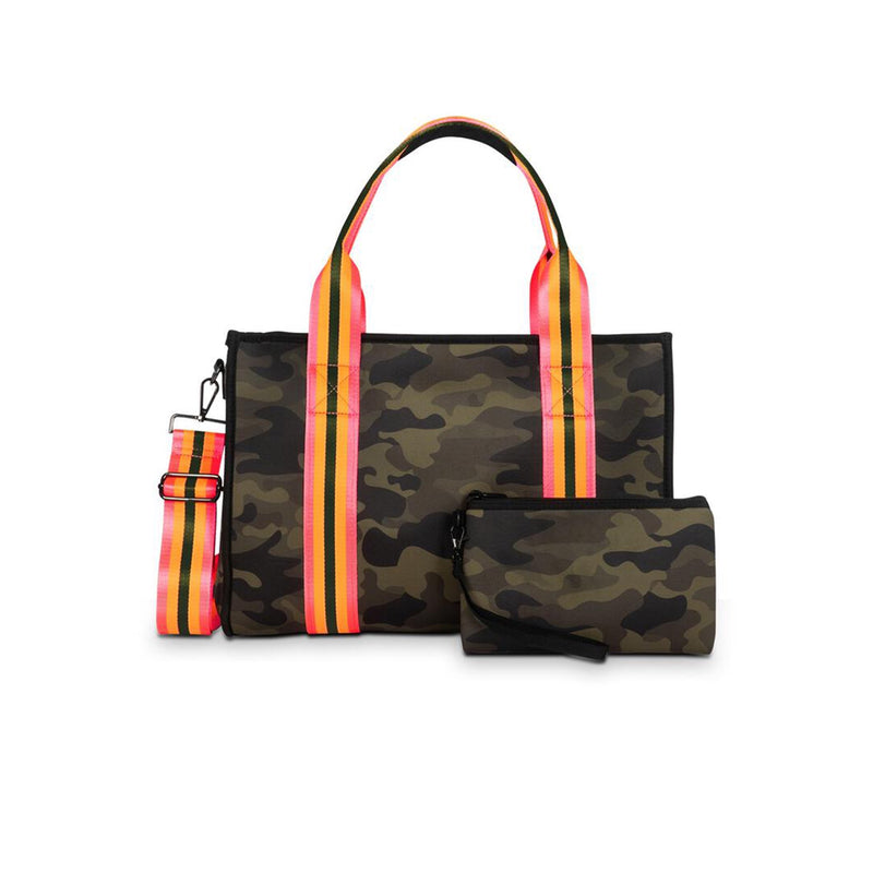 Haute Shore Isla Showoff Tote Bag. This structured book tote with shoulder straps and removable crossbody strap is perfect for everyday! Featuring a gorgeous camouflage material with a neon pink, orange, and black stripe detail and matching pouch. Pair this over any outfit to instantly elevate your look!