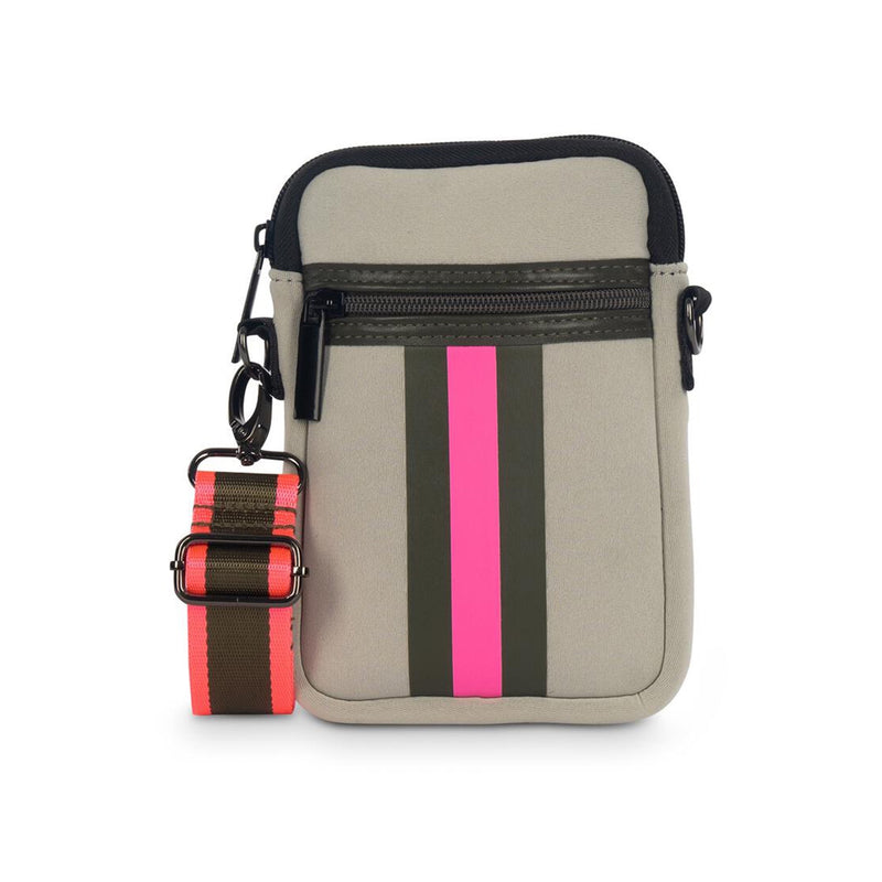 Haute Shore Casey Swank Crossbody Bag. The Haute Shore Casey Swank Crossbody is the perfect on the go companion! This cute bag offers compact construction that accommodates a phone, lipstick and has credit card slots. Featuring a beige colored material, army and hot pink stripe, and and pocket details.