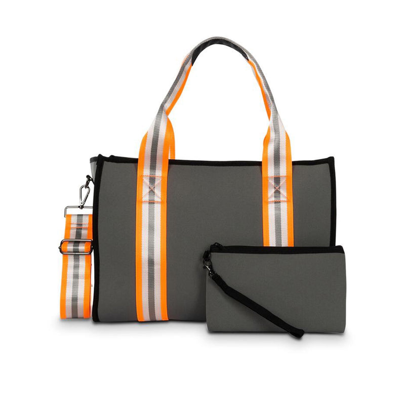 Haute Shore Isla Hip Tote Bag. This structured book tote with shoulder straps and removable crossbody strap is perfect for everyday! Featuring a grey colored material, and an orange, silver, and grey stripe detail, and removable wristlet.