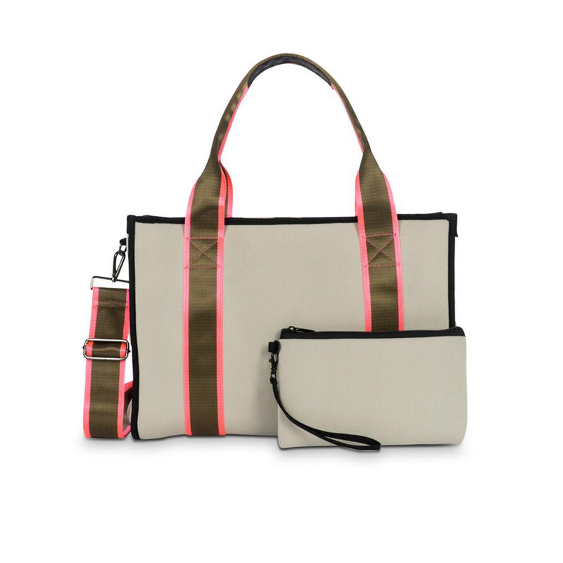 Haute Shore Isla Swank Tote Bag. This structured book tote is perfect for everyday! Featuring a beige colored material, hot pink and army stripe details, shoulder strap, removable crossbody strap, wristlet pouch detail, and interior pockets.
