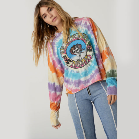 Daydreamer Grateful Dead Tie Dye Long Sleeve Top. Add a touch of fun to your wardrobe with this band tee! Featuring a trendy tie-dye material, long sleeves, and Grateful Dead logo. Pair with destroyed denim and sneakers for the coolest look.Daydreamer Grateful Dead Tie Dye Long Sleeve Top. Add a touch of fun to your wardrobe with this band tee! Featuring a trendy tie-dye material, long sleeves, and Grateful Dead logo. Pair with destroyed denim, sneakers, and your fave sunnies for the coolest look.
