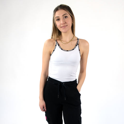 Juicy Couture Ribbed Halter Top. Nail all of this season's best trends by adding this top to your wardrobe! Featuring a halter top style, round neckline, Juicy Couture logo on neckline trim, and a bodycon fit. Tuck this into the matching joggers and fresh kicks for such a cool look.