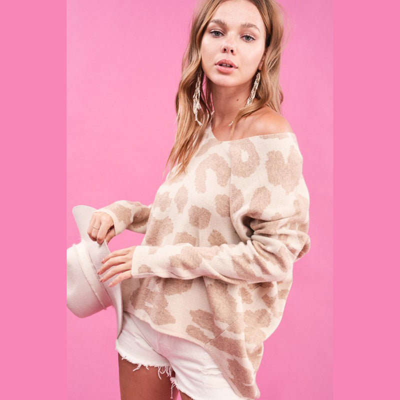 Leopard Printed Slouchy Sweater. Bring out your wild side in this super cute Leopard Printed Slouchy Sweater! This neutral toned leopard sweater is perfect for lounging with some leggings, or out and about with jeans and booties. This sweater is seriously a fall staple!