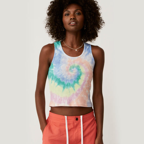 Daydreamer Prismatic Tie Dye Ribbed Tank Top. We've been quietly recreating the universally loved 90s baby tank. Set to capture the relaxed, low-key tone of an era, our Ribbed Tank Capsule arrives at just the right time for peak Summer heat. Taking a cue from the cool and carefree spirit we idolized from our favorite style decade - the look is fitted, shrunken, and inherently tomboy.