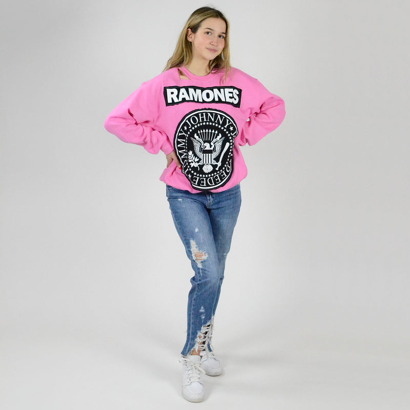 Ramones Long Sleeve Distressed Sweatshirt. Add some rocker vibes to your wardrobe with our new favorite sweatshirt! Featuring a soft sweatshirt material, Ramones graphic design, distressed details, round neckline, and a baggy fit. Pair this top with black joggers and slides for a cute lounge look.