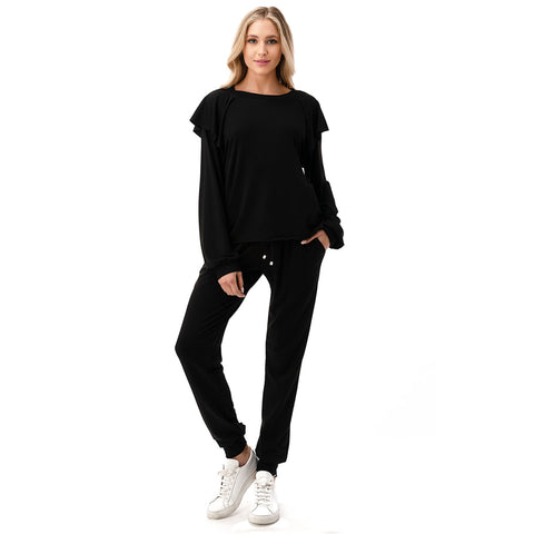 Long Sleeve Ruffle Shoulder Top. Switch up your loungewear look with this super fun look! Featuring long sleeves, an ultra comfy material, ruffle shoulder detail, and loose fit. Pair with the matching high waisted joggers, oversized sunnies, and a mini backpack for an effortless everyday look.