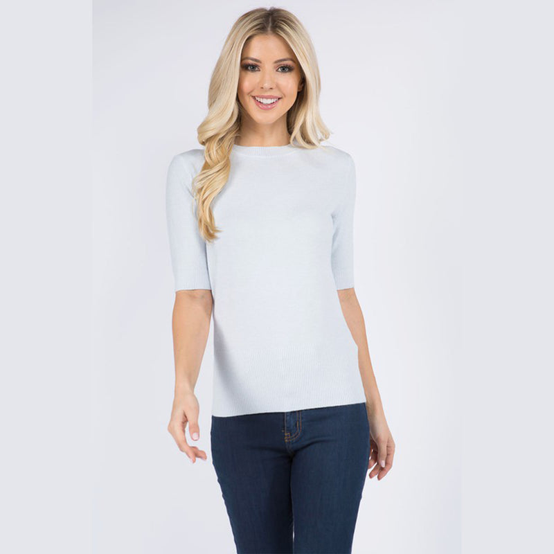 Moonbeam High Neck Short Sleeve Sweater. Add some chic vibes to your knitwear collection with this sweater! Featuring a soft knit material, short sleeves, high neckline, and cinched bottom detail. Team this piece with distressed jeans, white boots, and a shoulder bag for a look we are obsessing over.