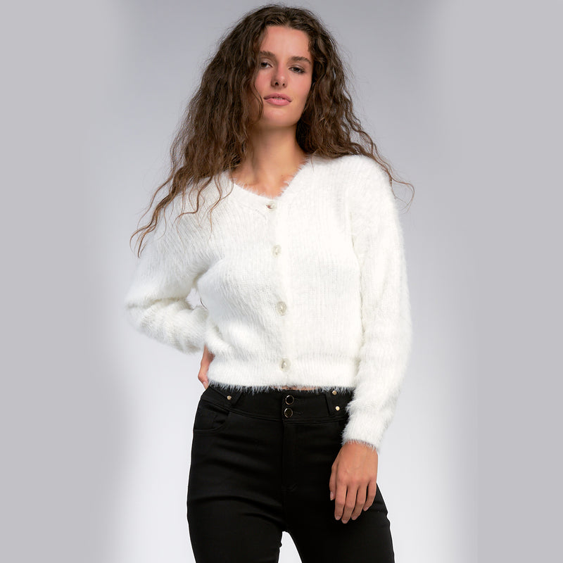 Eyelash Cropped Cardigan. Hop on the trend of all things fuzzy, with this adorable Eyelash Cropped Cardigan! Featuring front button closures, an on-trend cropped body and the coziest eyelash fabric. This sweater is perfect for winter time!