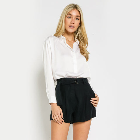 Satin Collared Button Up Shirt. Everyone needs this classic in their closet! Featuring a beautiful satin material, long sleeves, button up closure, collar detail, and a loose fit. Tuck this beauty into a mini skirt and strappy heels for the most dreamy date night look.