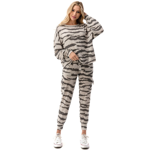 Long Sleeve Zebra Printed Top. This trendy top is sure to elevate your look! Featuring a gorgeous zebra printed material, long sleeves, and a loose fit. Dress up with leather pants and chunky boots, or dress down with the matching zebra joggers.