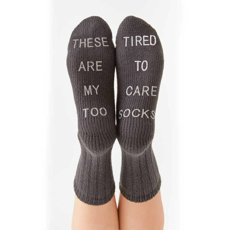 Z Supply Too Tired Rib Knitted Socks. Make a statement in our new cozy rib knit socks! Each sock features a phrase and together make the statement 'too tired to care.' The statement also work as grippers on the bottom of the socks. These Too Tired Rib Socks are a great add-on item and will go with your lounge wardrobe perfectly.