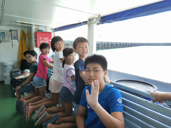 Children on a ferry to St John's island