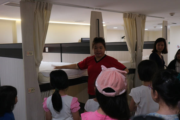 High Achievers Instructor Stressing that kid should not jump off the bed
