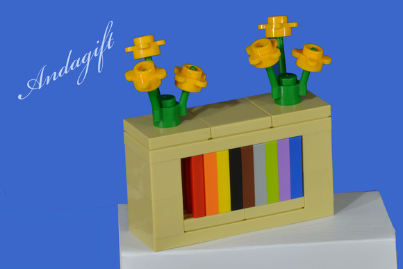 LEGO bookcase shelves with yellow flowers and instructions - andagift