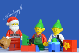 LEGO SANTA'S WORKSHOP Father Christmas and 2 elves finish making the presents - andagift