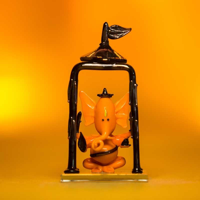 Bal Ganesh Orange Glass Idol in Temple