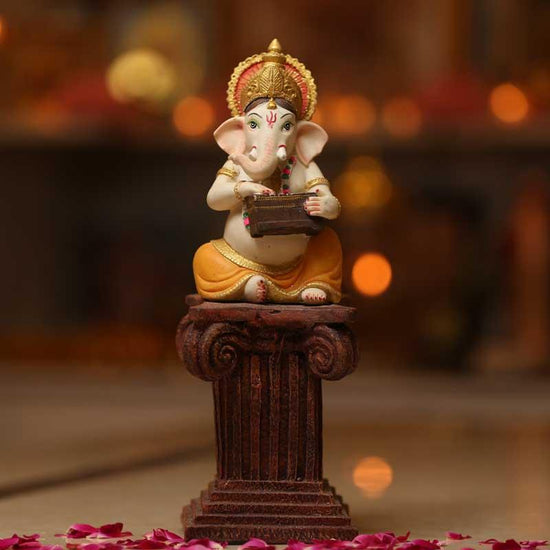 Divine Ganesh Murti on a Pillar