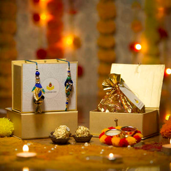 Pretty Peacock Shaded Bhaiya Bhabhi Petite Rakhi Box with Ferrero Rocher/Dry Fruits