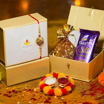 Auspicious OM Petite Rakhi Box with Dairy Milk/Dry Fruits