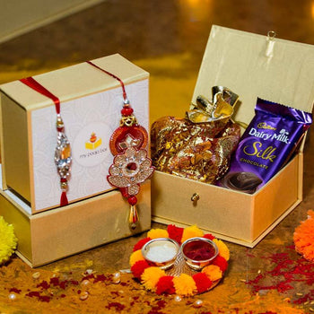 Elegant Petite Box with Bhaiya Bhabhi Rakhi and Dairy Milk/Dry Fuits