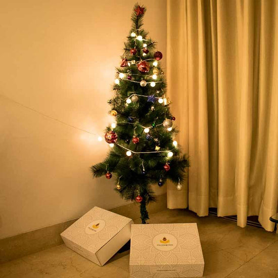 christmas tree with metal stand and decorative items 5 ft