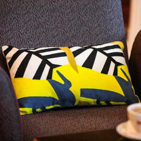 Yellow and black jungle print cushion - Woven Riches