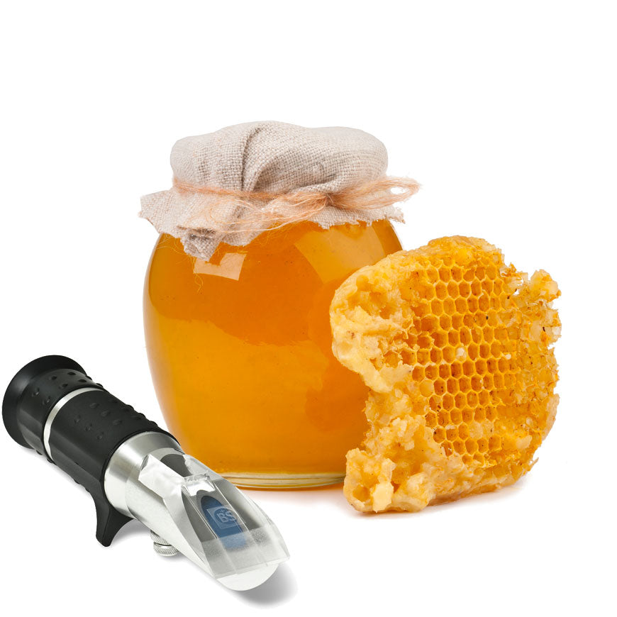 Optical refractometer for testing water in honey