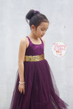 Eggphant flower girl dress with gold sash.