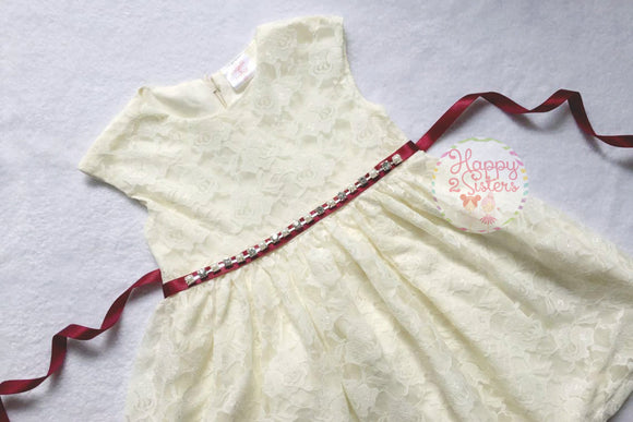 Lace ivory girl dress with burgandy sash.
