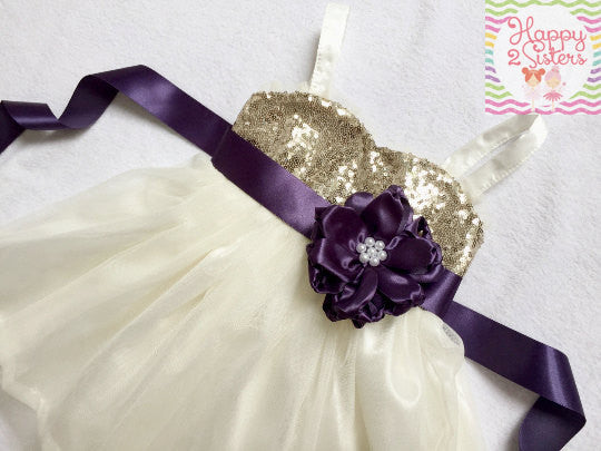 Gold and ivory flower girl dress with plum sash