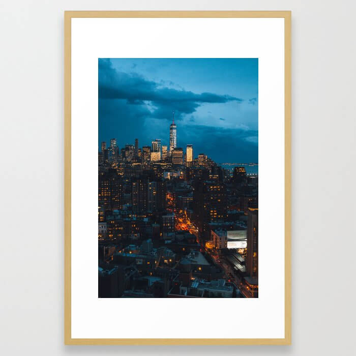 Evening lights over Downtown NYC Framed Art Print