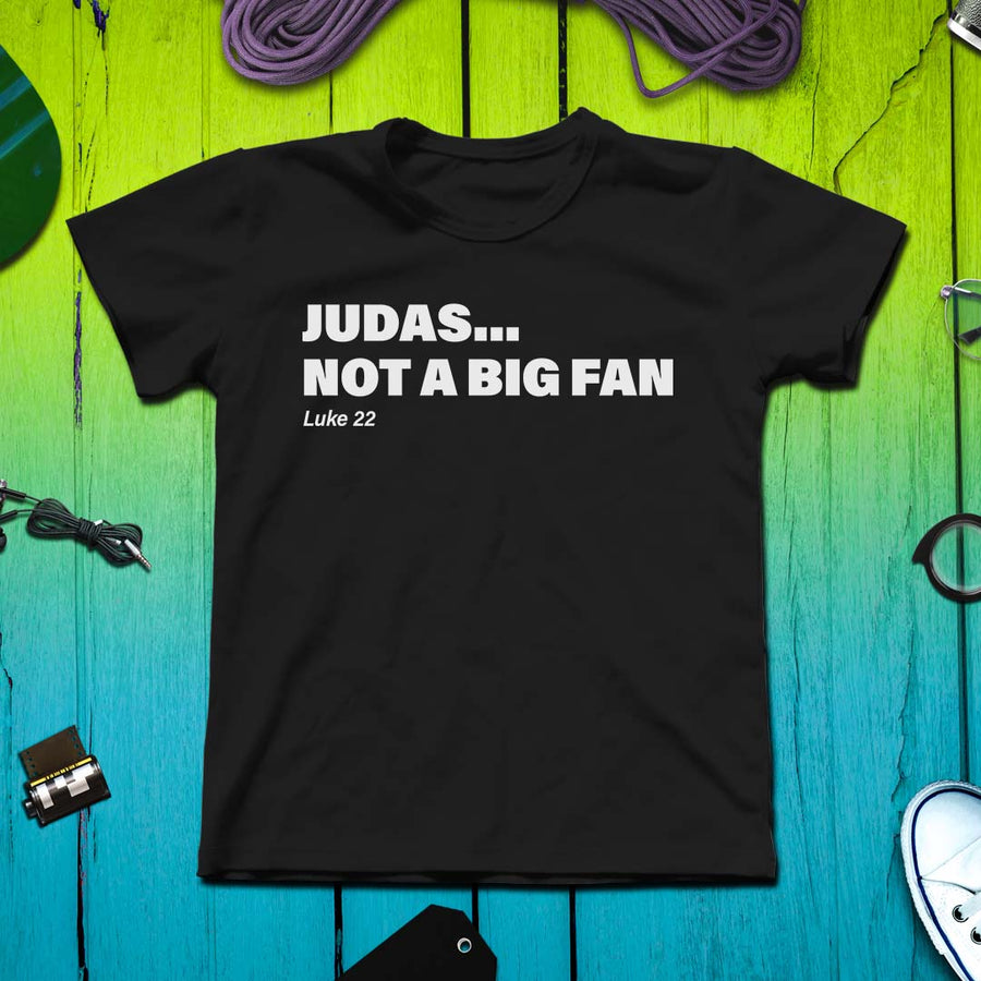 Judas... Not a Big Fan Christian Tshirt o a colored background