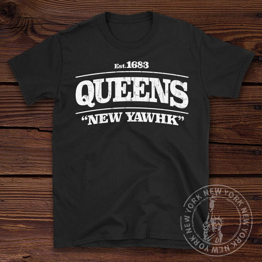 Queens New York Tee shown on a wooden background
