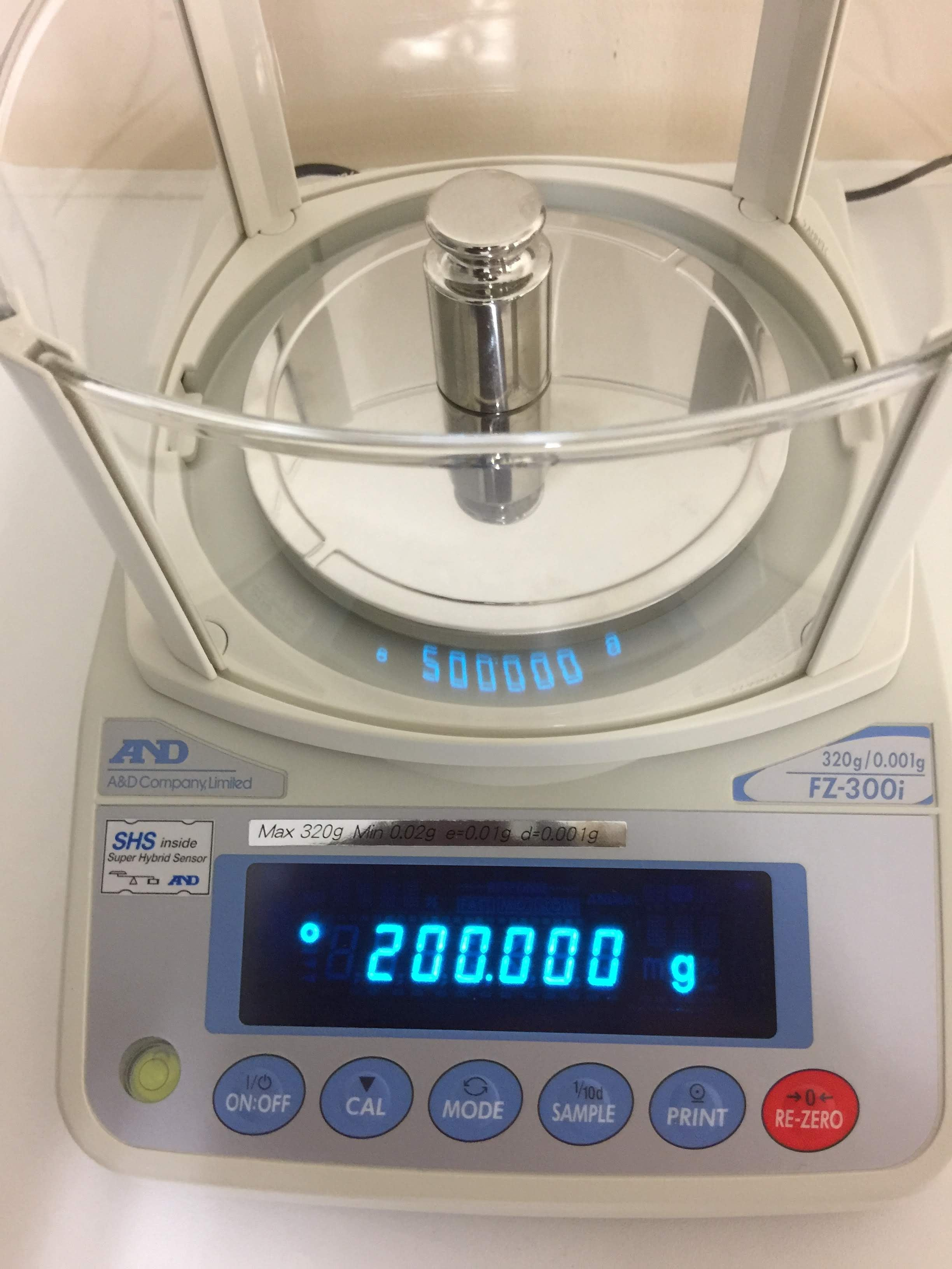 Weight placed on the balance, digital screen shows 200.000g in blue