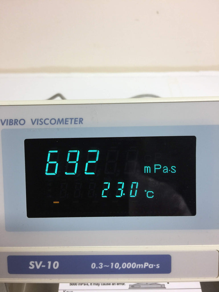 Close up of screen showing 692mpas and 23°C in blue
