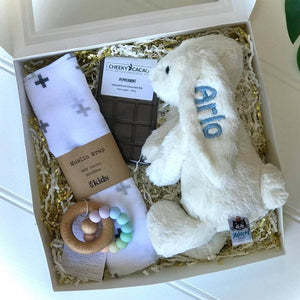 Personalised newborn gift hamper Australia and NZ.  Gift box contains personalised jellycat bunny, cheeky cacao chocolates, ES Kids, Bella Zailea teether
