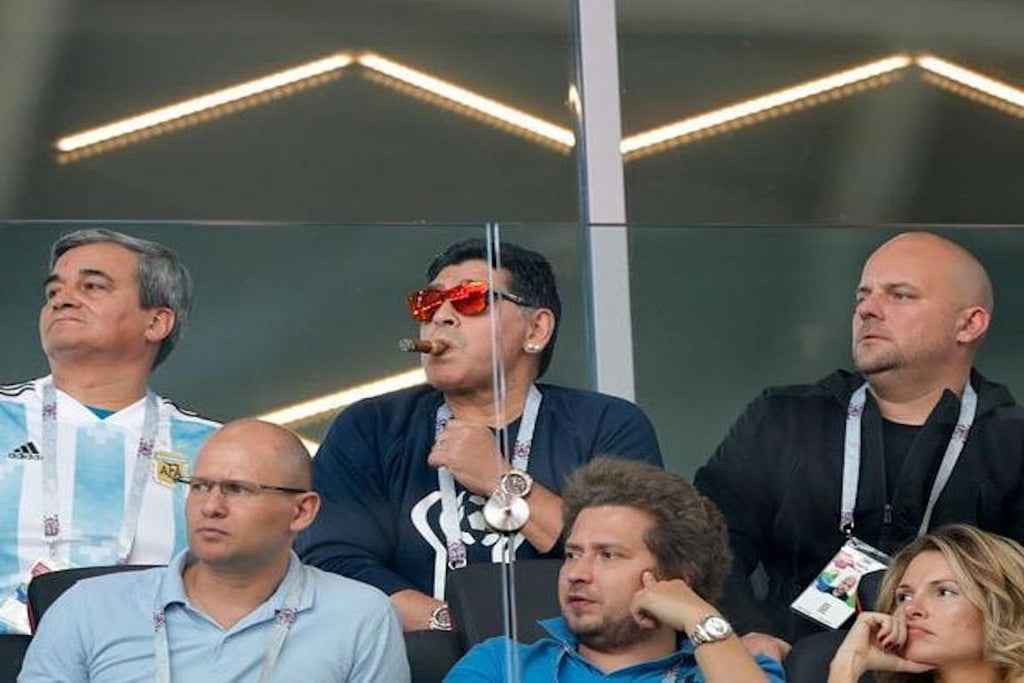 Diego Maradona smokes Cohiba Cuban cigars at World Cup