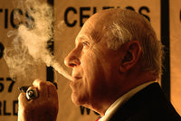 "Arnold ""Red"" Auerbach: Basketball Coach and Cigar Enthusiast"