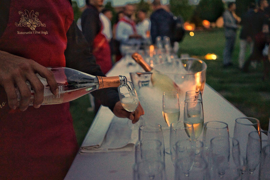 Champagne being poured for guests- Cuban cigars online