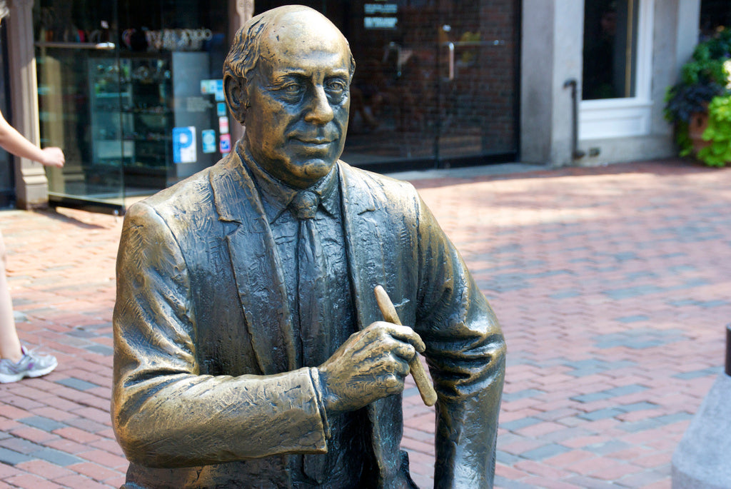 Red Auerbach's bronze statue holding a Cigar in boston EGM Cigars