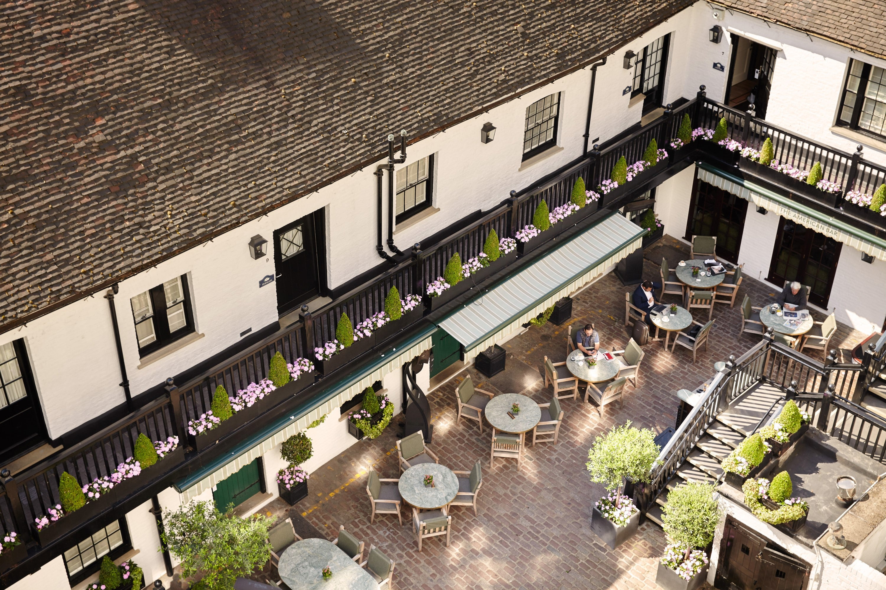 The Courtyard at The Stafford Hotel's American Bar as seen from above.