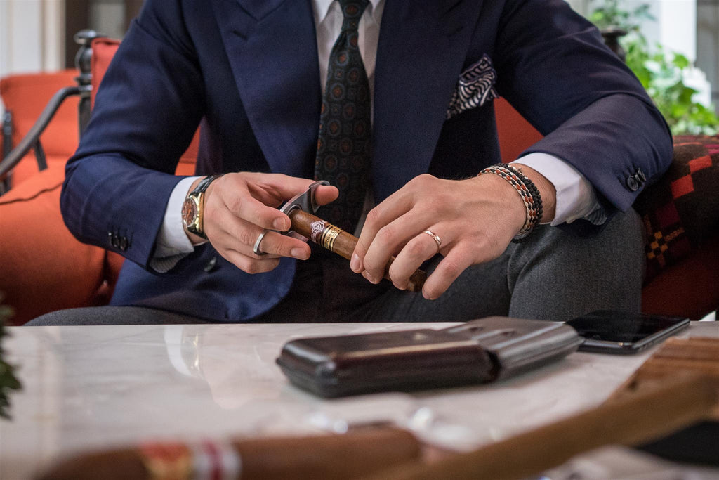 Cuban cigars being cut in The Corinthia Hotel