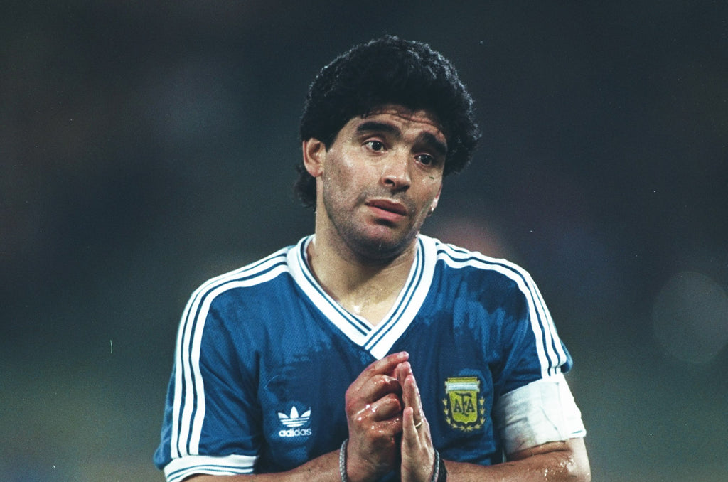 A young Diego Maradona who enjoys smoking Cohiba Cuban Cigars