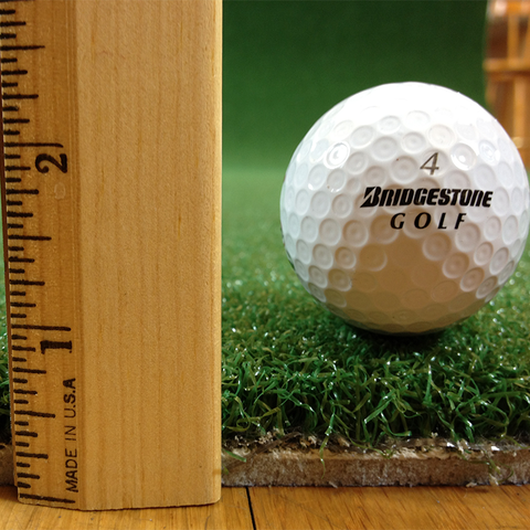Ruler Thickness with Golf Ball Showing Thickness of Pro Turf