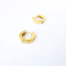 simple yellow gold huggies by Savage Jewellery